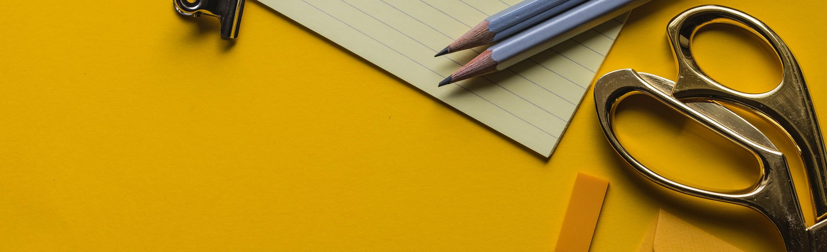 Office Supplies on Yellow Paper